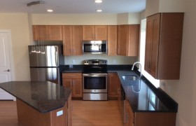 brown kitchen cabinets at meridian at eagleview apartments in exton, pa